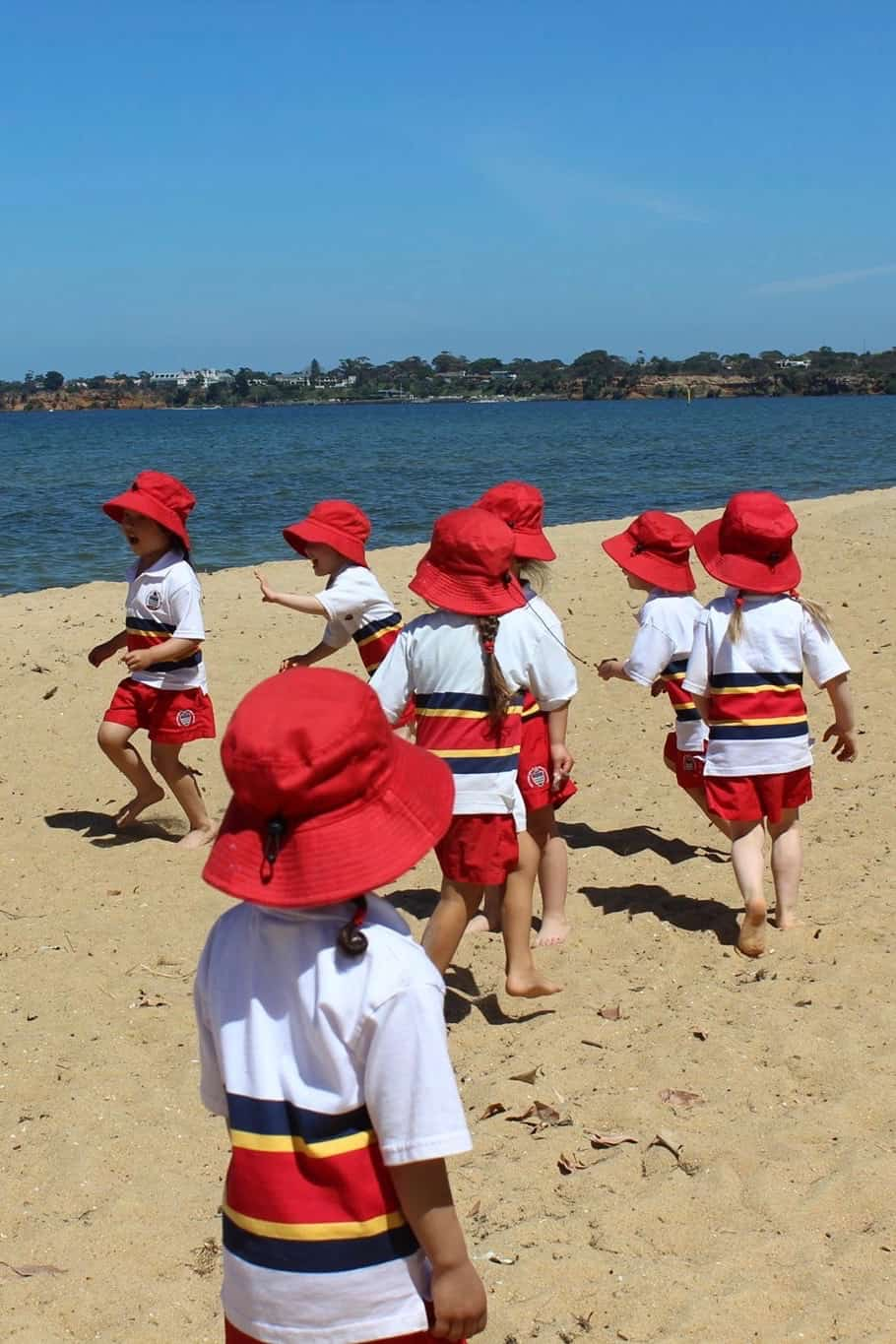 early learning students on the beach